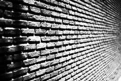 Μαύρος τουβλότοιχος, υπόβαθρο πλινθοδομής στοκ εικόνα