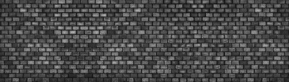 Μαύρος τουβλότοιχος, ευρεία πανοραμική σύσταση επιφάνειας πετρών Στοκ Εικόνες