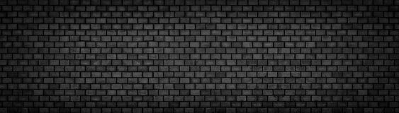 Μαύρος τουβλότοιχος, ευρεία πανοραμική σύσταση επιφάνειας πετρών Στοκ φωτογραφία με δικαίωμα ελεύθερης χρήσης
