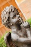 Μαύρο άγαλμα του cupid Στοκ φωτογραφίες με δικαίωμα ελεύθερης χρήσης
