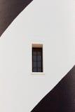 Μαύρο άσπρο χρωματισμένο παράθυρο φάρων τουβλότοιχος στοκ φωτογραφίες με δικαίωμα ελεύθερης χρήσης