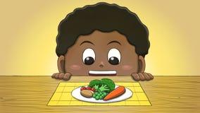 Μαύρο αγόρι που εξετάζει τα λαχανικά Στοκ Φωτογραφία