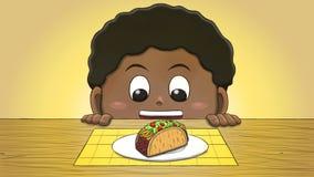 Μαύρο αγόρι που εξετάζει Taco Στοκ Εικόνα