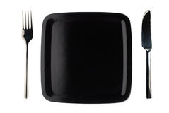 μαύρο απομονωμένο πιάτο Στοκ Εικόνες
