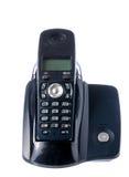 Μαύρο ασύρματο τηλέφωνο που στηρίζεται στη βάση Στοκ Εικόνες