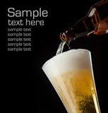 μαύρο γυαλί μπουκαλιών μπύρας στοκ εικόνες