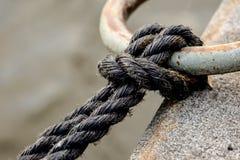 Μαύρο δαχτυλίδι σχοινιών και αγκύρων Στοκ Εικόνες