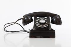 Μαύρο, εκλεκτής ποιότητας περιστροφικό τηλέφωνο στο λευκό Στοκ φωτογραφία με δικαίωμα ελεύθερης χρήσης