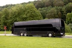 Μαύρο λεωφορείο ταξιδιού στοκ εικόνες