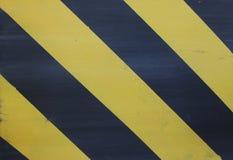 Μαύρο και κίτρινο ριγωτό υπόβαθρο στοκ εικόνα