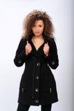 μαύρο κορίτσι παλτών Στοκ εικόνες με δικαίωμα ελεύθερης χρήσης