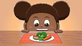 Μαύρο κορίτσι που εξετάζει τα λαχανικά Στοκ φωτογραφία με δικαίωμα ελεύθερης χρήσης