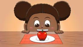 Μαύρο κορίτσι που εξετάζει τη Apple Στοκ Φωτογραφία