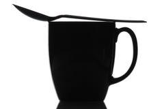 μαύρο κουτάλι κουπών καφέ Στοκ Εικόνες