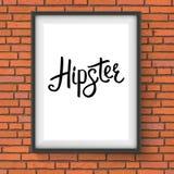 Μαύρο μήνυμα Hipster σε ένα πλαίσιο που κρεμά σε έναν τοίχο απεικόνιση αποθεμάτων