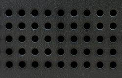 Μαύρο μεταλλικό πιάτο με το σχέδιο τρυπών Στοκ φωτογραφία με δικαίωμα ελεύθερης χρήσης