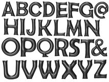 Μαύρο μπαλόνι φύλλων αλουμινίου αλφάβητου που τίθεται με το ψαλίδισμα της πορείας Στοκ φωτογραφία με δικαίωμα ελεύθερης χρήσης