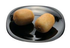 μαύρο πιάτο ακτινίδιων στοκ εικόνα με δικαίωμα ελεύθερης χρήσης