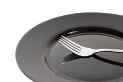 μαύρο πιάτο δικράνων Στοκ Εικόνες