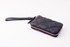 Μαύρο πορτοφόλι με το χρυσό φερμουάρ στοκ εικόνες