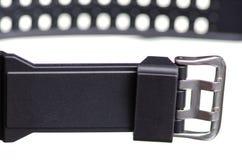Μαύρο ρολόι με τη λαστιχένια αθλητική μακροεντολή βραχιολιών στοκ φωτογραφίες με δικαίωμα ελεύθερης χρήσης