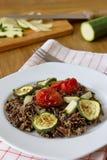 Μαύρο ρύζι με τα κολοκύθια, τις ντομάτες και την πάπρικα Στοκ φωτογραφία με δικαίωμα ελεύθερης χρήσης