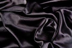 μαύρο σατέν ανασκόπησης Στοκ Φωτογραφίες