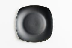 Μαύρο τετραγωνικό πιάτο τοπ άποψης Στοκ Εικόνες