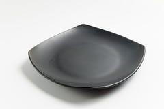 Μαύρο τετραγωνικό πιάτο Στοκ Φωτογραφίες