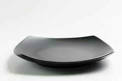 Μαύρο τετραγωνικό πιάτο Στοκ φωτογραφία με δικαίωμα ελεύθερης χρήσης