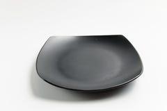 Μαύρο τετραγωνικό πιάτο Στοκ φωτογραφίες με δικαίωμα ελεύθερης χρήσης
