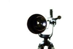 Μαύρο τηλεσκόπιο σε ένα άσπρο υπόβαθρο Προσοχή των αστεριών Στοκ Φωτογραφία