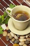 μαύρο τσάι φλυτζανιών Στοκ Φωτογραφία