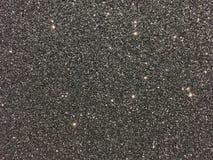 Μαύρο υπόβαθρο με τα σπινθηρίσματα Στοκ φωτογραφία με δικαίωμα ελεύθερης χρήσης