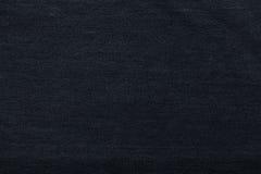 Μαύρο υπόβαθρο, υπόβαθρο τζιν τζιν Σύσταση τζιν, ύφασμα Στοκ Φωτογραφία