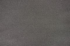 Μαύρο υπόβαθρο υφασμάτων χονδροειδούς σιταριού Στοκ εικόνες με δικαίωμα ελεύθερης χρήσης
