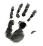 Μαύρο χέρι στην άσπρη ανασκόπηση Στοκ Φωτογραφία
