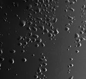 μαύρο ύδωρ σταγονίδιων αν&alph Στοκ Φωτογραφίες