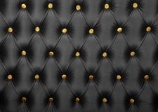 Μαύρο capitone με τη χρυσή σύσταση κουμπιών Στοκ εικόνες με δικαίωμα ελεύθερης χρήσης