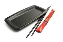 μαύρο chopsticks πιάτο κάλυψης Στοκ Φωτογραφία