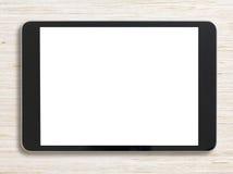 Μαύρο PC ταμπλετών στο λευκαμένο ξύλινο υπόβαθρο Στοκ φωτογραφία με δικαίωμα ελεύθερης χρήσης