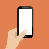 Μαύρο smartphone χεριών holdng στο πορτοκαλί υπόβαθρο απεικόνιση αποθεμάτων