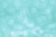 Μαλακό υπόβαθρο aqua κρητιδογραφιών Bokeh με τα θολωμένα άσπρα φω'τα Στοκ Εικόνα
