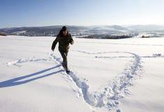 μεγάλη καρδιά που κάνει το σημάδι ατόμων Στοκ Εικόνες
