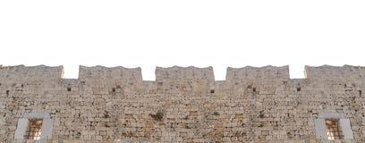 Μεγάλος μεσαιωνικός παλαιός τοίχος πετρών κάστρων πύργων που απομονώνεται στο λευκό Στοκ Εικόνες