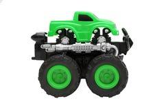 Μεγάλο παιχνίδι φορτηγών με τις μεγάλες ρόδες, bigfoot, φορτηγό τεράτων που απομονώνεται στο άσπρο υπόβαθρο Στοκ Εικόνες