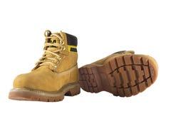 Μεγάλα κίτρινα παπούτσια με τα τραχιές πέλματα και τις δαντέλλες Στοκ Φωτογραφίες