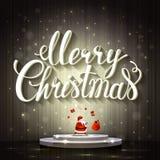 Μεγάλη άσπρη Χαρούμενα Χριστούγεννα εγγραφής Άγιος Βασίλης κάνει ταχυδακτυλουργίες με τα δώρα στο στάδιο Στοκ εικόνες με δικαίωμα ελεύθερης χρήσης
