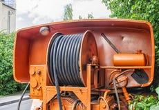 Μεγάλη σπείρα μετάλλων με το ηλεκτρικό καλώδιο σε ένα ειδικό αυτοκίνητο Στοκ Εικόνες