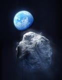 Μεγάλοι μετεωρίτης και πλανήτης Γη Στοκ Εικόνες
